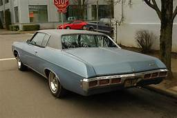 OLD PARKED CARS 1969 Chevrolet Impala Custom Hardtop