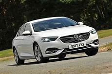 new vauxhall insignia grand sport vs used audi a4 which