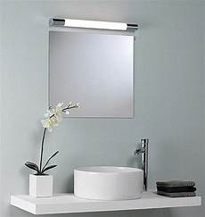 above the mirror lighting how to light up your bathroom