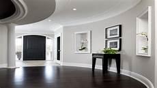 laundry room flooring light gray walls with dark floors