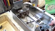 ultrasonic cleaning of a carburetor with tickopur r33