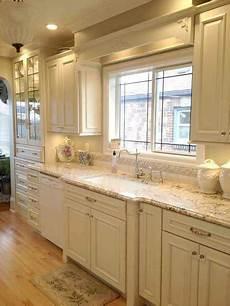 beautiful kitchen creamy white cabinets cream kitchen cabinets painting kitchen cabinets