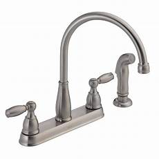 delta kitchen faucet handle delta foundations 2 handle standard kitchen faucet with side sprayer in stainless 21988lf ss