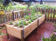 Gardening Systems by All Season Self Watering Container Garden System The Arch
