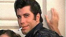 grease and hairspray travolta tells me he