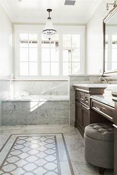 Brown And Gray Bathroom With Clear Beaded Chandelier