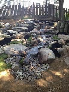 Wasserspiel Stein Garten - pondless waterfall backyard renovation pond landscaping