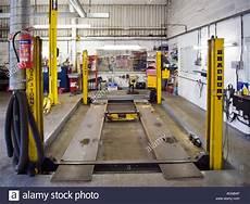 Garage Hydraulic Lift by Car Repair Garage With Hydraulic Car Lift Stock Photo