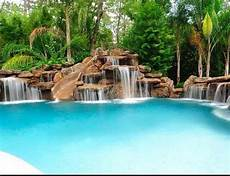 Pool Mit Wasserfall - this pool with a slide waterfall combo looks like a