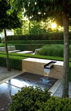 Moderner Garten Brunnen Sitzecke Lounge Wasserbecken