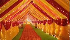 vibrant outdoor wedding tent red orange yellow tent