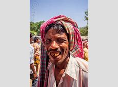 indian man smiling, betel nut teeth, india