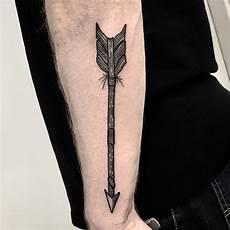 arrow tattoo on the forearm by deborah pow tattoogrid net