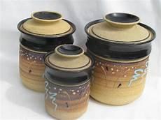 pottery kitchen canisters vintage unglazed stoneware pottery kitchen canisters