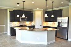 Kitchen Island Cabinet Layout by Gourmet Kitchen Boasts Beautiful Granite Counter Tops