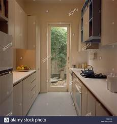 Kitchen Door To Garden by Narrow Galley Kitchen With A Glass Door To The Garden