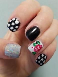 rose nail design with polka dot and chrome nail accent