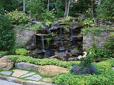 Wooded Landscape With Waterfall And Wall Hgtv