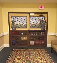 Nursing Home Decor Ideas by Window Bookcase Mural On A Set Of Doors Leading