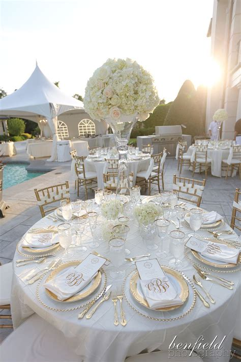 Tall white hydrangea centerpiece on all white tables with
