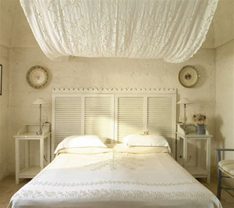 Plantation Shutter Headboard by How Upcycling Can Elevate Your Home Decor