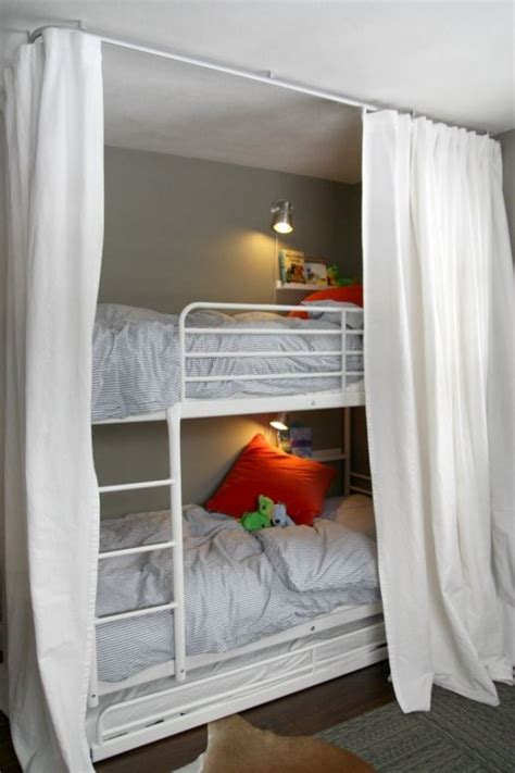 A bunk bed that save space by folding into a wall. 25 Functional And Stylish Kids' Bunk Beds With Lights - DigsDigs