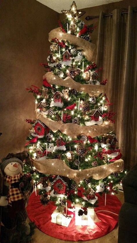 christmas tree decorated  red white  brown coloured