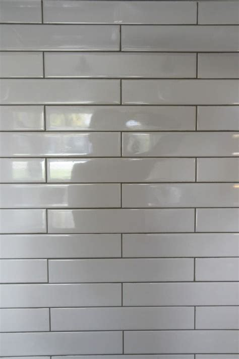 backsplash 2 x12 white subway tile and a contrasting warm gray grout kitchen