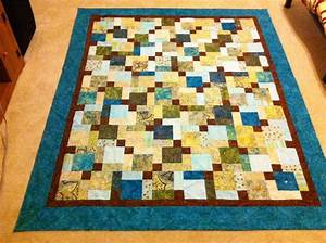 You have to see Disappearing Nine Patch Batik Quilt by D