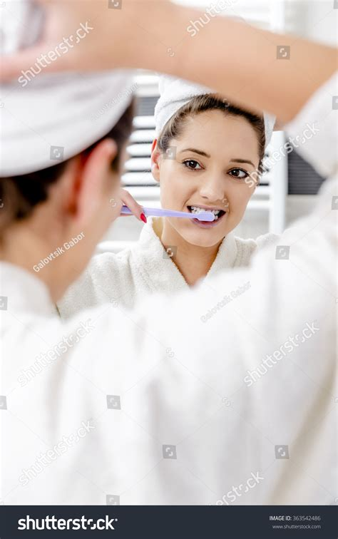 Beautiful Woman Cleaning Her Teeth Bathroom Stock Photo