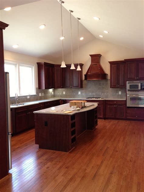 Kitchen cherry cabinets with gray tile   cherry kitchen