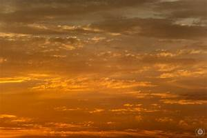 Orange Sunset Sky and Clouds Background