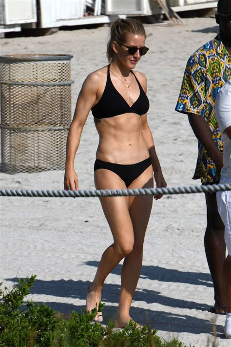 ellie goulding sports a black bikini while enjoying a day ...