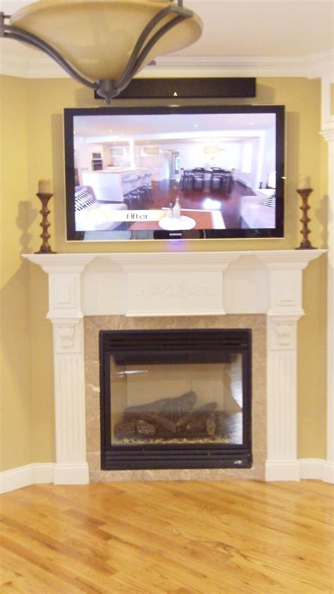 above tv tv over fireplace with sound bar above home theater