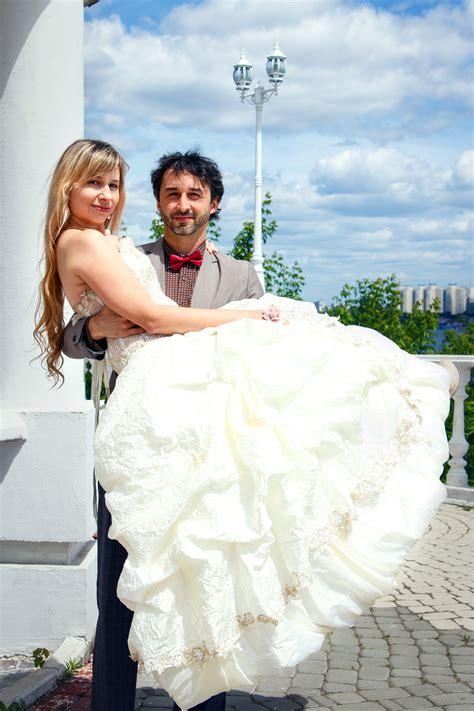 woman wearing pink wedding gown standing   man