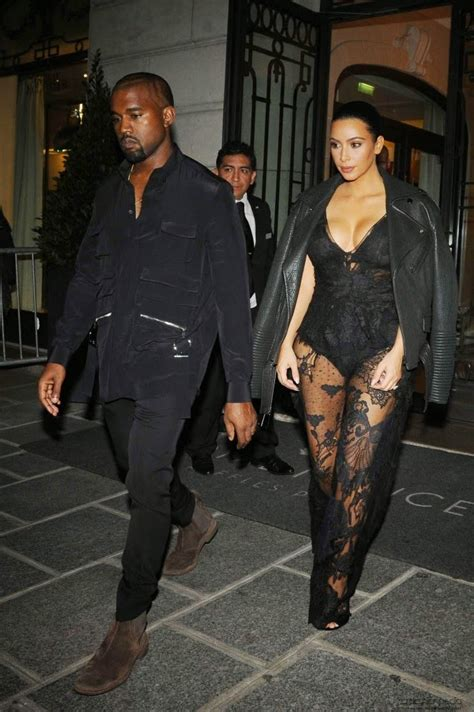 Kim Kardashian wears a plunging black lace jumpsuit to the ...