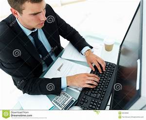 Royalty Free Stock Photos: Young business man working on ...