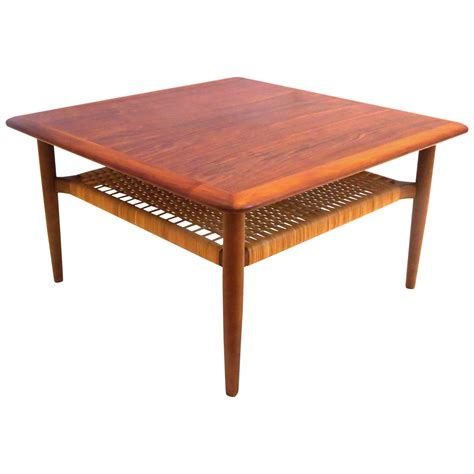 modern square coffee table danish modern 1950s square coffee table with caned shelf