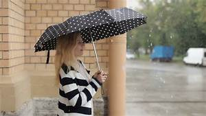 Young, Girl, With, An, Umbrella, Walking, In, Heavy, Rain, In, The, City, Stock, Video, Footage