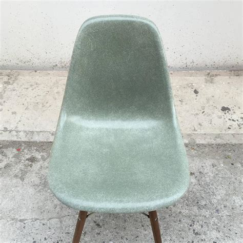 eight herman miller eames seafoam green dining chairs at