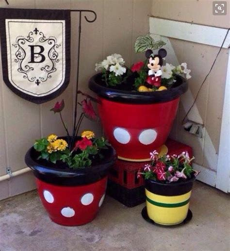 disney garden decor 25 best ideas about mickey mouse bathroom on