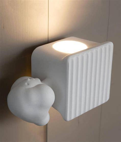 magicians trick inspired ceramic led wall light