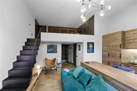 small room with mezzanine mezzanine level bedroom adds extra space to small kiev apartment