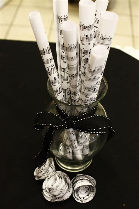 music themed table decorations recital decorations rolled up sheet music in a vase with