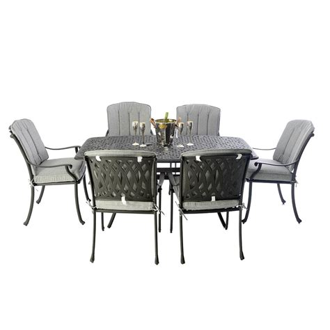 black metal boat shaped table set with 6 venetian chairs