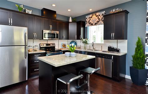 dark kitchen cabinets with light countertops granite countertops dark cabinets stainless steel