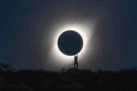 amazing solar eclipse photography shows  holding