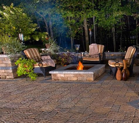 backyard living space with firepit patio and decorative