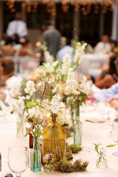 bohemian wedding flowers mismatched bottles  flowers