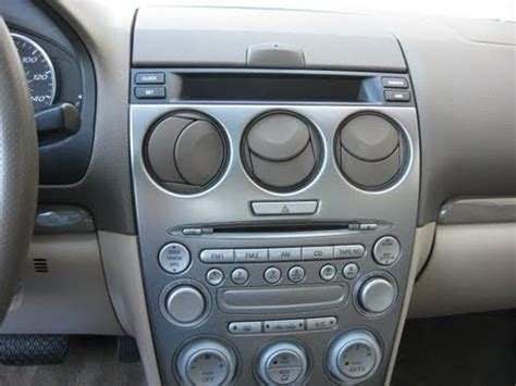 how to remove radio cd changer display clock from mazda 6 2004 for repair